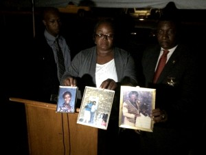 Cassandra Banks's sister, Gail Black, holds up pictures of Cassandra and her daughter, Melody, to be remembered.