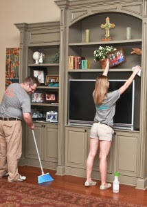 Cory Wise (left) and Courtney Buckley (right) work together to clean a residence. Wise and Buckley work for Student Maid, owned by Kristen Hadeed.