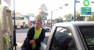 Christoper Stidham, 21, fills up his Nissan Hardbody Tuesday at the BP at 931 W. University Ave.
