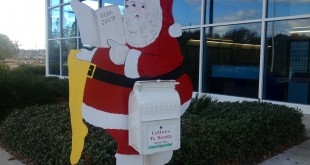 The drop box for letters to Santa stands at the left entrance of the Gainesville Post Office. Mail handlers check the drop box for submissions four to five times a day.