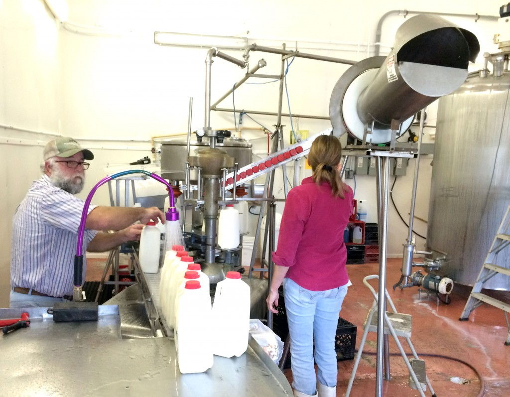 Howard Kurtz and his wife Leslie bottle raw milk at their dairy in Live Oak, Florida on Tuesday, Decmeber 17th in preparation for delivieries the next day.