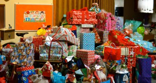 A pile of donated presents sits at Northwest Baptist Church waiting to be distributed by Partnership for Strong Families to children who were victims of abuse.