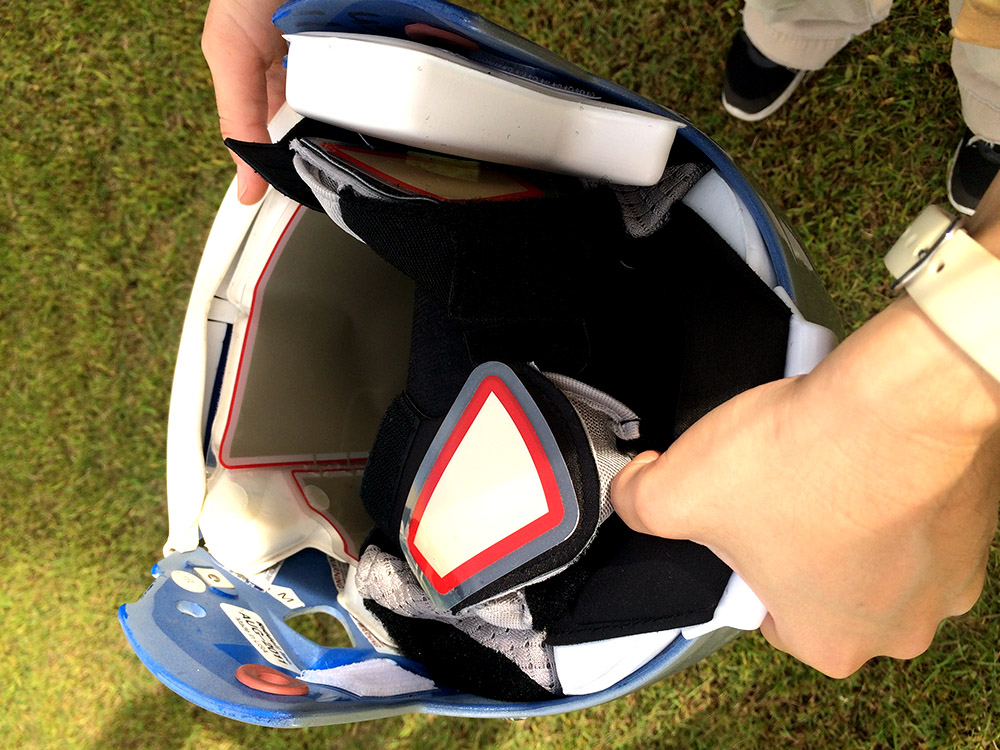 Certified athletic trainer Melissa Goo displays the InSite technology inside the helmet.