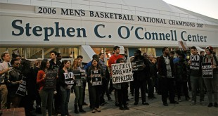 Students and community members line up outside Gate 1 of the O'Connell Center.