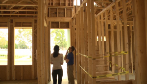 Alex Skobel and Loree Schulson inspect one of the Skobel Homes properties. This home is in one of the company's latest communities.