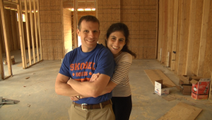 Alex Skobel and his girlfriend Loree Schulson share a moment in one of the Skobel Homes properties. Schulson joked she was trying to steal Skobel's warmth while touring the home on a cold Sunday.