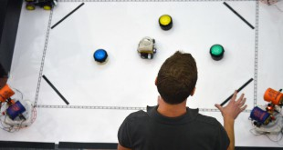 """Jacob Easterling tests his """"Team Clean Sweep"""" for the crowd. These displays were used as a final grade for the Intelligent Machines Design Lab course."""