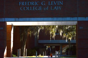 A woman walks through the entrance of the University of Florida Levin College of Law Wednesday. Minorities make up about 34 percent of the law school's enrolled students.