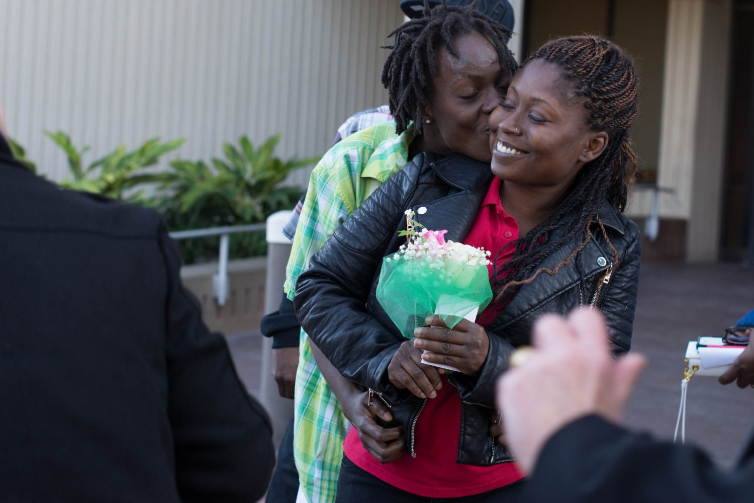 Quintyra White embraces newlywed wife LaKindra Ellis-White after receiving their marriage license outside the Alachua County Courthouse on Tuesday, Jan. 6.