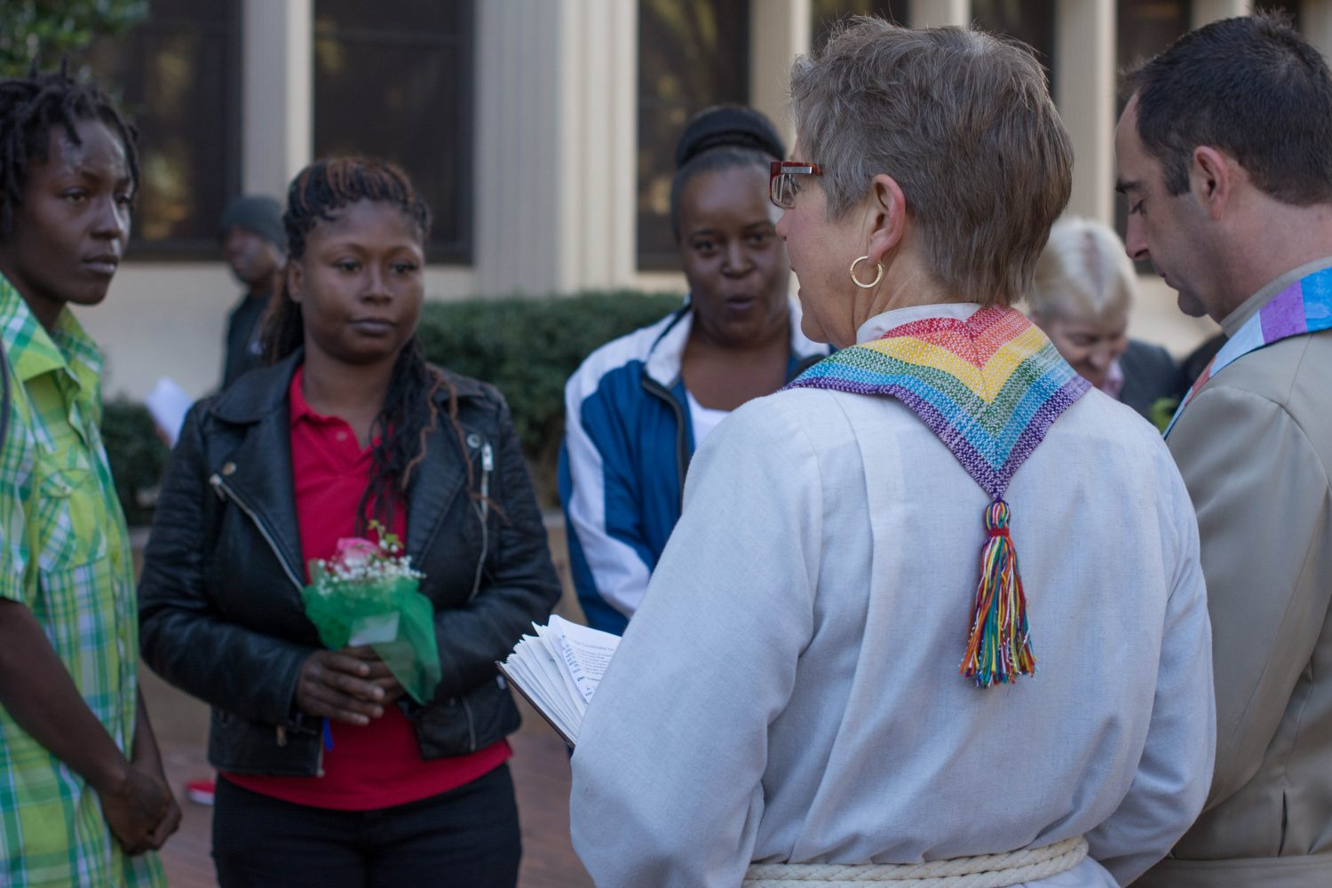Senior Minister Shelly Wilson of the United Church of Gainesville facilities the wedding reception of Quintyra Ellis White (left) and LaKindra Ellis White (middle) with witness Stephanie Greer (right) outside the Alachua County Courthouse on Tuesday, Jan. 6.