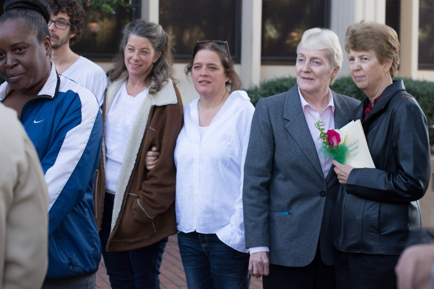 From left, Kat Drawdy, Joy Drawdy, Lola Yousey and Karen Niederkohr watch the wedding reception of LaKindra Ellis-White and Quintyra White outside the Alachua County Courthouse Tuesday, Jan. 6.