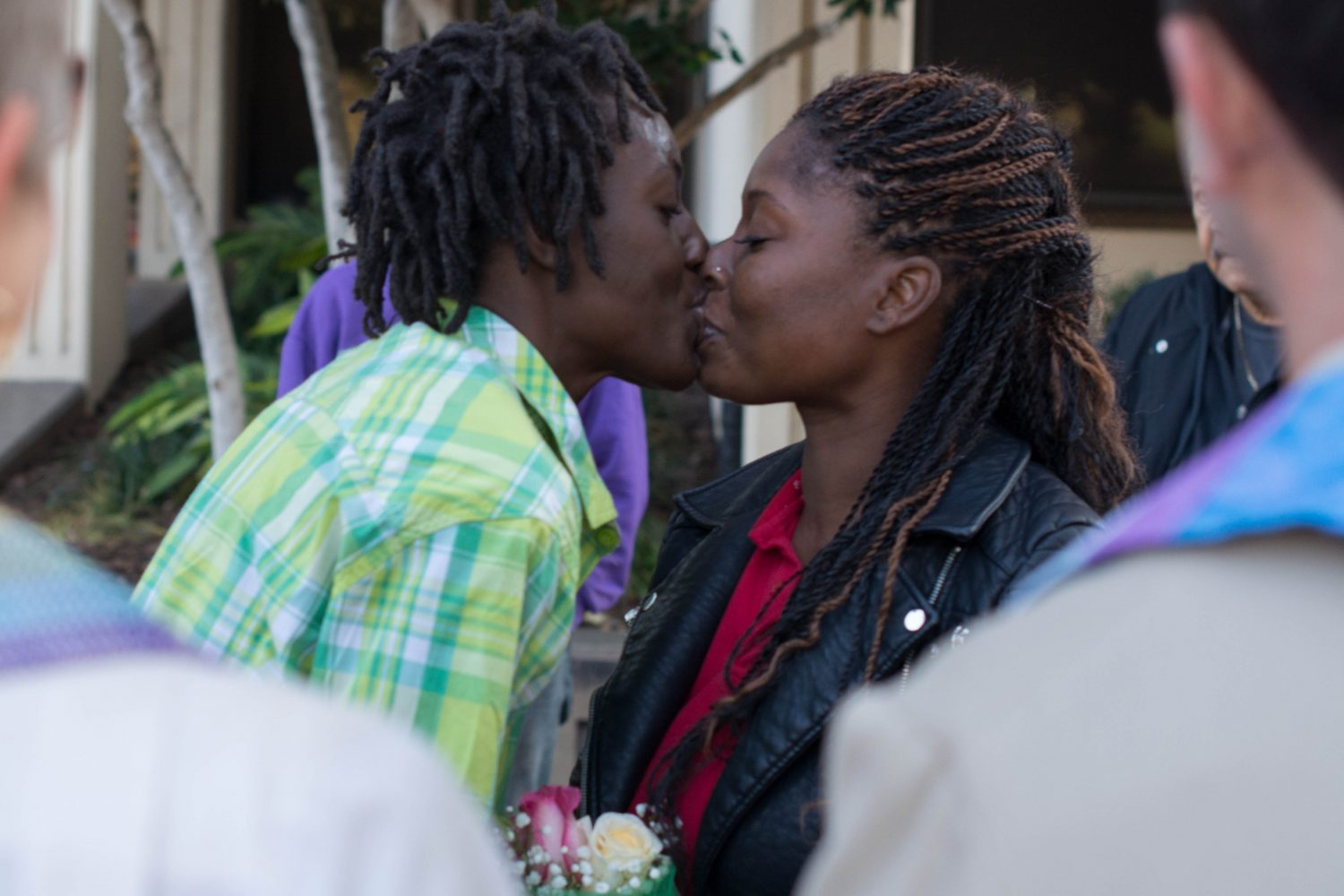Gainesville residents Quintyra White (left) shares her first kiss with wife LaKindra Ellis-White on Tuesday, Jan. 6 outside the Alachua County Courthouse.
