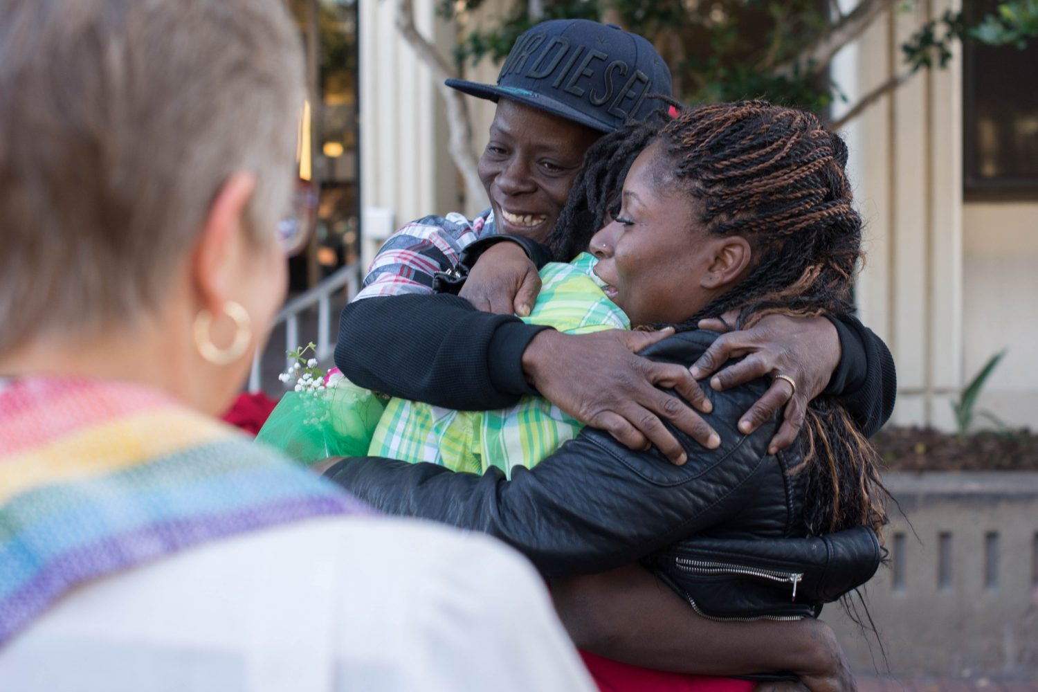 Gainesville residents Debra White (left) and LaKindra Ellis-White (right) embrace Quintyra White (middle) after Quintyra and LaKindra successfully attain their marriage license outside the Alachua County Courthouse on Tuesday, Jan. 6.