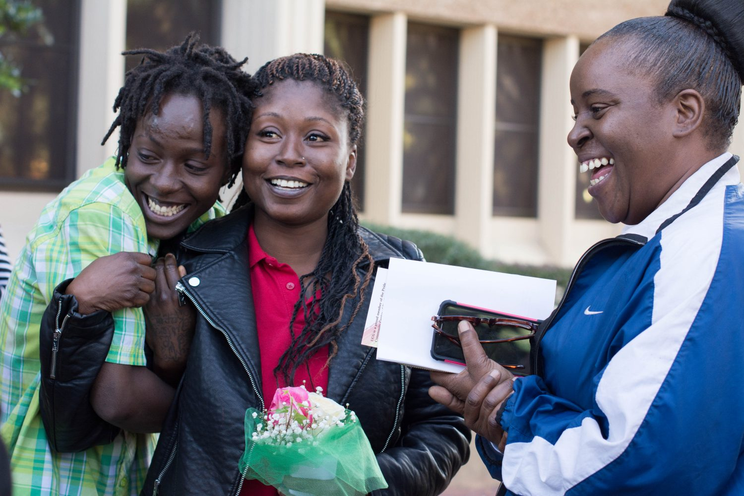 Gainesville newlywed Quintyra White embraces wife, LaKindra Ellis-White after attaining their marriage license. Witness Stephanie Greer celebrates with them outside the Alachua County Courthouse on Tuesday, Jan. 6.