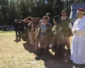 """Members of the Thieves' Guild line up to prepare for their final dress rehearsal before opening day at the Hoggetowne Medieval Faire. The group will perform """"the human chess board"""" three times a day during the festival."""