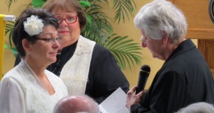 Jo Posillico, left, and Lyn Echard exchange wedding vows at Unitarian Universalist Fellowship of Marion County. The two have been together for 38 ½ years and finally officiated their marriage on Jan. 10 despite the fact that many clerks of court in Florida counties have stopped performing marriage ceremonies.