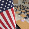[FILE] A file photograph showing an American Flag and empty student desks inside an Atlanta, Georgia school.