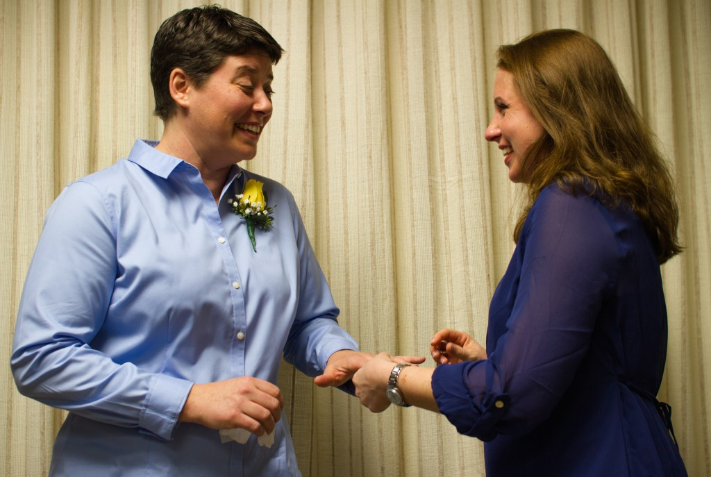 Elizabeth Rodgers places a ring on Jodi Hall's hand during their wedding ceremony at the Alachua County Courthouse Tuesday, Jan. 6. Alachua County issued 28 same-sex marriage licenses Tuesday after Florida's ban on same-sex marriage was lifted at midnight.