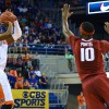 Arkansas's Bobby Portis  (10) closes in on Florida's Eli Carter (1) as he pulls up for a jump shot.