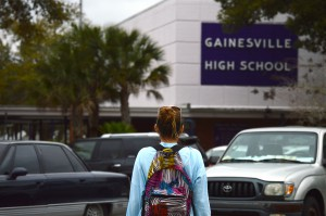 A student walks into Gainesville High School Tuesday. There are proposed changes to standardized testing in high schools, including the suspension of 11th grade FSA English and Language Arts.