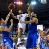 Florida's Kasey Hill (0) fights his way toward the basket, going up strong against  Kentucky's Karl-Anthony Towns (12) and Devin Booker (1).