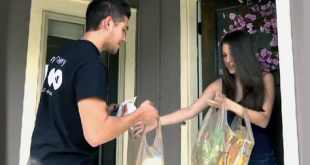 Personal liaison Daniel Araque delivers groceries to a Gainesville resident. Lazy Delivery offers delivery from any brick and mortar stores in the area within two hours.