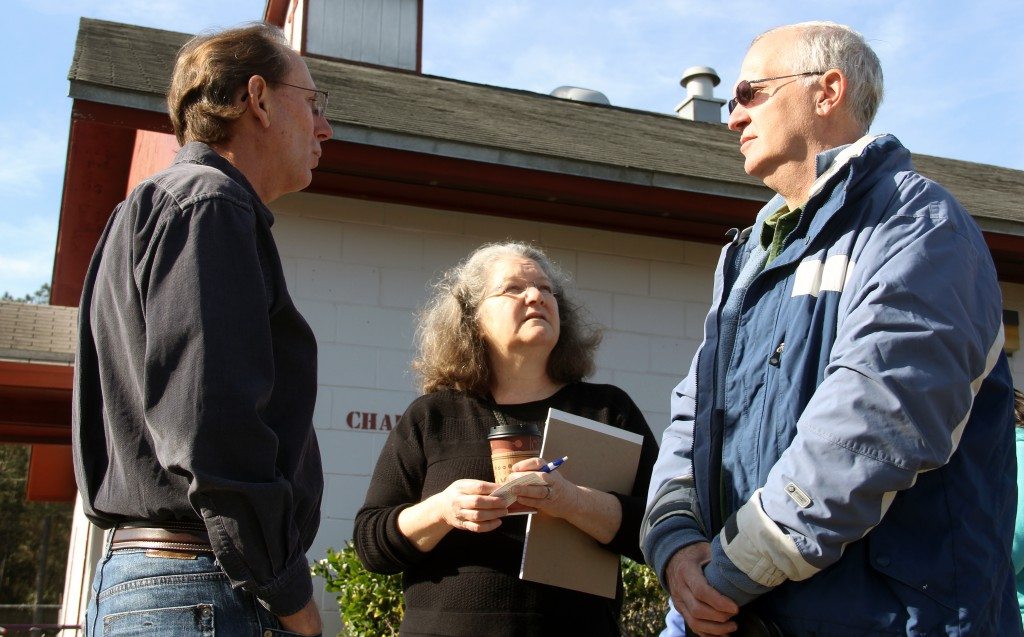 Ray Brady, left, president of the state's Eighth Judicial Circuit Bar Association, talks with Marcie Green, middle, pro bono coordinator at Three Rivers Legal Services, and Wes Marston, a lawyer who volunteered at Saturday's event.