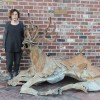 Nava Ottenberg has led the plan for installing public art downtown. Ottenberg stands outside Persona, her vintage shop downtown, next to Peruvian artist Victor Delfín's stag sculpture. Ottenberg is inspired by travelling the world and seeing art in other cultures. Italy is her favorite travel spot. Christine Flammia/ WUFT NEWS