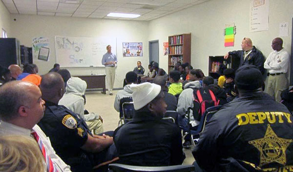 Police and minority youth sit together as Jeffrey Wesiberg leads a discussion on how to de-escalate conflict and decrease minority youth arrests as part of the Gainesville Police Department's Police-Youth Dialogue Program. The department recently received a new grant that will help expand the program throughout Florida. Photo courtesy of River Phoenix Center for Peacebuilding.
