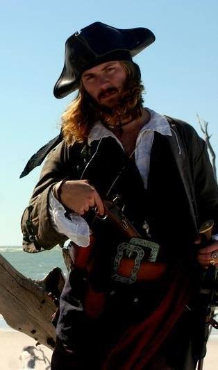 Donald Ridenbaugh, 27, stands on a beach in Sarasota dressed in 17th inspired clothing as Captain Jack D. Stifler, a persona he takes on with his live history pirate group named the Crew of the Scavenger. Ridenbaugh spends a lot of time and money making clothes and collecting period-based accessories to create this character.