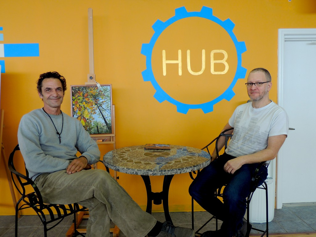"""SoMa Art Media Hub co-owners Celino Dimitroff, left, and Charley McWhorter sit where they hope local artists will soon collaborate on projects. """"We all work together; this is a hub,"""" McWhorter said of the local artist community."""
