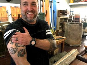 Owner of The Talented Cookie Company and Speakeasy tattoo parlor David Newton shows off a tattoo of his three daughter's names. David is one of four entrepreneurs opening shop in The Corner, a community retail space designed with family in mind.