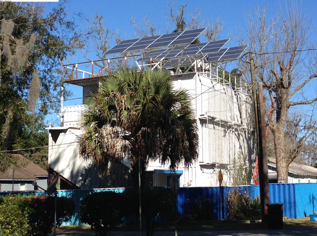Tom Fox's three-story, shipping container home houses an array of 36 solar panels on his roof. Fox said the panels will pay for all his electric needs over the next 50 years.