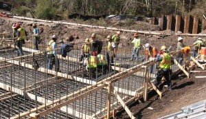 Construction workers from Superior Construction Company Southeast work on replacing the culvert underneath the Oakleaf overpass in Clay County on Wednesday, Feb. 11.