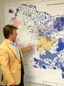 "Caption: Alachua County Commissioner Ken Cornell points to a map of the county's surface water. Some believe fracking deep underground could cause pollution up on the surface in water sources. ""We need to make sure we have protections in place to protect the water supply,"" Cornell said."