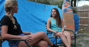Marley Boerema (left) and Jenna Curtis talk about what they look to accomplish with Barrels for Boobs while sitting under a covered half pipe.  Curtis said the hope is that the philanthropy will be something carried down for years in Wahines of the Waves.  RJ Schaffer/WUFT News