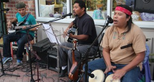 Tierra Libre band members Russell Perez (left), Amancio Perez and Silvestre Hernandez play Latin American music outside of Artisans' Guild Gallery for visitors passing by on Friday, March 27, 2015. Tierra Libre has been a band for 5 years. (Photo by Sydney Dixon)