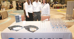 Foresight Construction Group employees attend a trade fair sponsored by the Central and North Florida Minority Supplier Development Council. From left to right, Melissa Segarra, marketing director, Juan Segarra, president and Maritza Rovira-Forino, minority business manager.