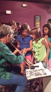 Barbara Armbrecht teaches a Blues in the Schools program at the Hippodrome in downtown Gainesville. She often uses the call-and-response technique: She yells out and the kids respond. This method gets them involved and teaches them about the historical significance of where blues music came from in America. (Courtesy of Mark Armbrecht)