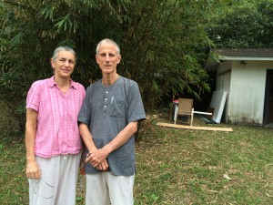 Yadubara Das and his wife, Visakha Dasi, stand in the backyard of their home in Alachua. The editing process and the final details are being completed inside the couple's home. (Photo by Russell Schaffer)