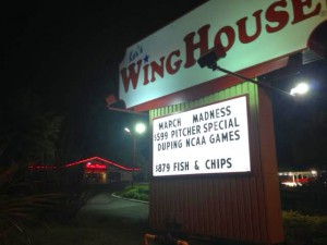 Ker's WingHouse Bar and Grill advertises its pitcher special for the NCAA Tournament. WingHouse, along with other local sports bars in Gainesville, is struggling to maintain the same level of sales from previous NCAA Tournaments.
