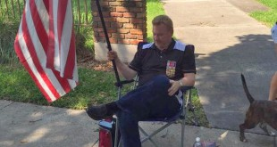 A veteran sits outside the ZBT fraternity on University of Florida campus in Gainesville, Fla. Friday, April 24, 2015.