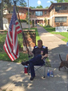 Army veteran Perry Clawson sits in front of the ZBT fraternity house on the University of Florida campus in Gainesville, Fla. Friday, April 24, 2015.