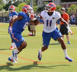 Quincy Wilson (6) covers wide receiver Demarcus Robinson (11) during an April 2015 practice. Wilson, a cornerback, and offensive tackle David Sharpe announced they're leaving the University of Florida early for the NFL draft. (WUFT file photo)