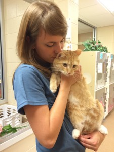 "Rachel Warnes cuddles ""Golden Boy"" at Alachua County Animal Services. ""Golden Boy"" receives a great deal of socialization by volunteers at ACAS."
