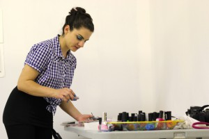 """Rosemarie Romero, a Gainesville artist, uses nail polish as paint over an image of a naked woman in her studio in Gainesville. Her ongoing performance piece """"porn nails"""" was part of her master's thesis at UF."""