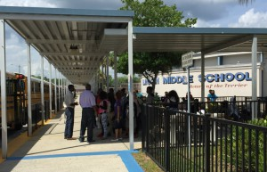 Students at Lincoln Middle School gather outside after the school received a bomb threat. The call came in around 1:30 p.m. on Friday.