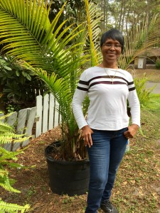 Marvene Edwards poses for a portrait in front of one of her palm trees outside her Gainesville home.