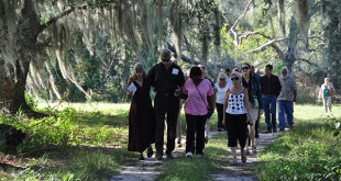 Doug Hornbeck walks with mourners through the woods during his mother's funeral at Prairie Creek Conservation Cemetery. Courtesy of Doug Hornbeck.