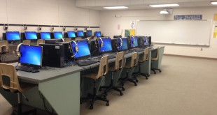 The computers in the media center at A.L. Mebane Middle School in Alachua are being equipped with the Fast ForWord learning program. The computer-based program is a part of Superintendent Owen Roberts' language development initiative.